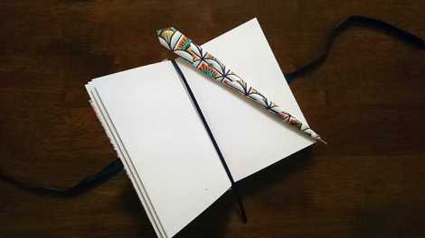 Quill pen and white page