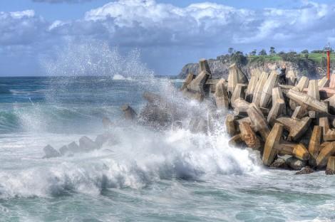 wave breaking against sea wall